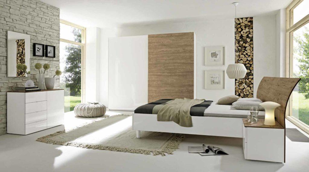 Camera da letto con particolari in essenza rovere miele