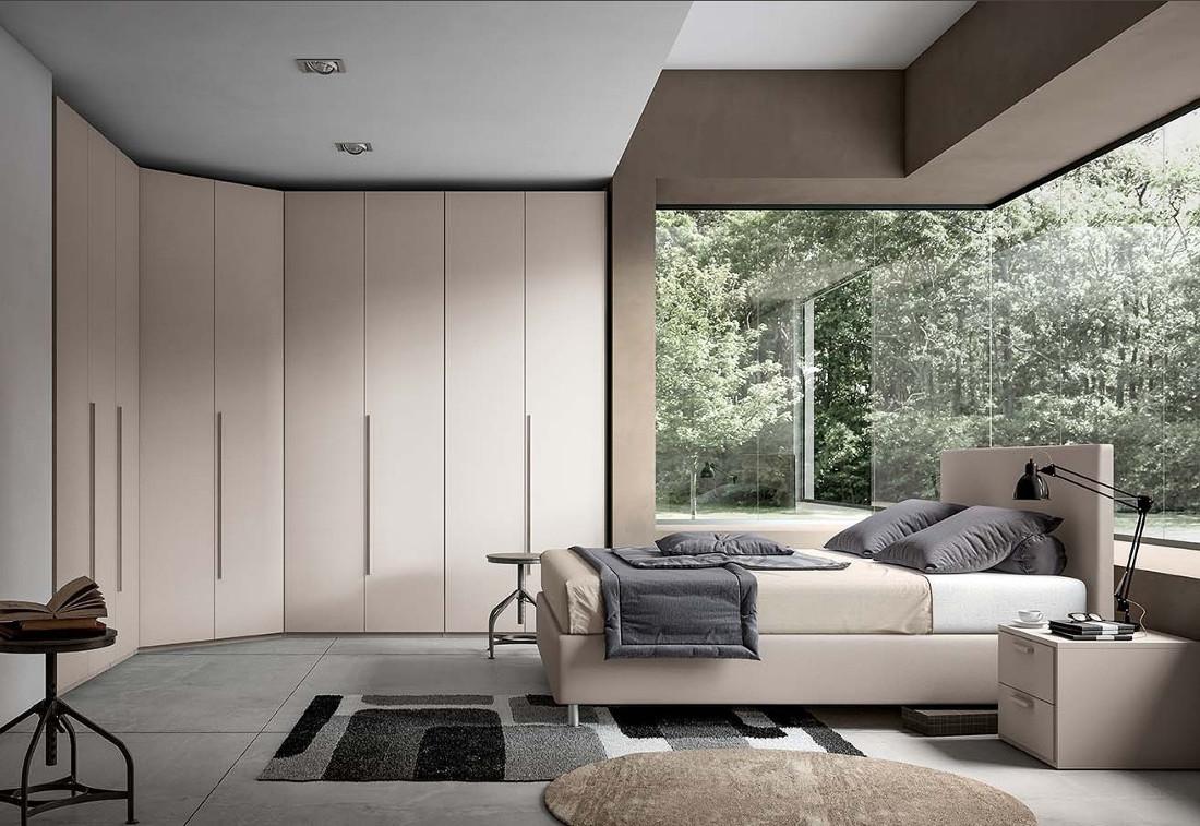 Camera matrimoniale touch con angolo spogliatoio e letto for Arredamento camera letto matrimoniale